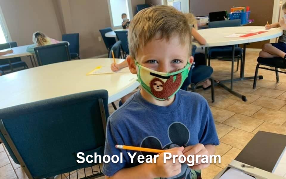 little boy with mask for school year program