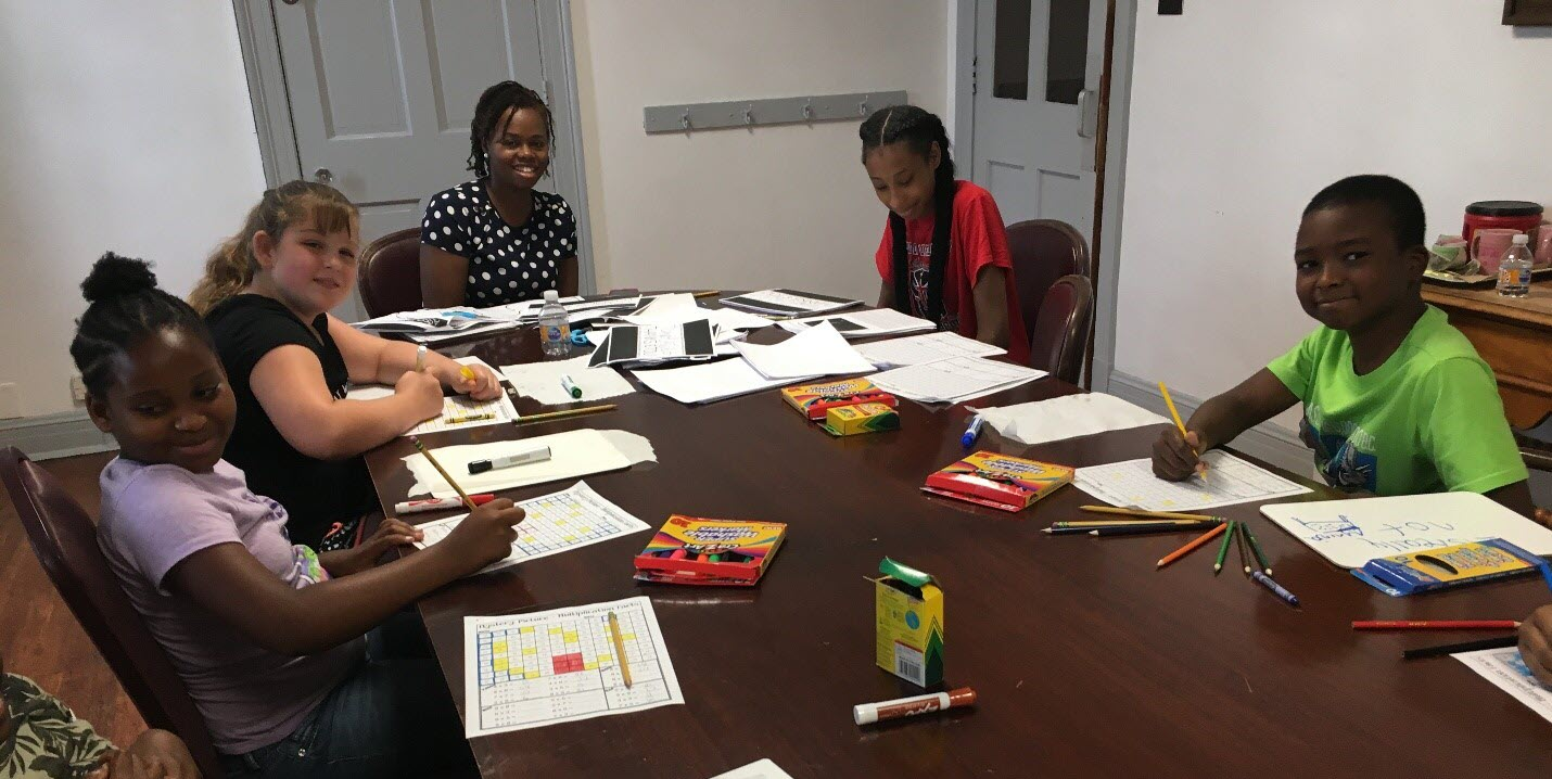 tutoring students around table